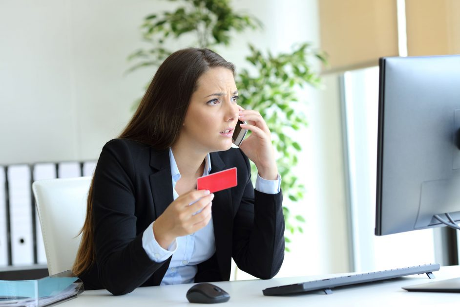 woman on phone confused with credit score