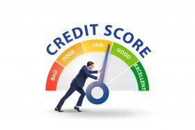 man pushing needle on credit score higher from fair to good
